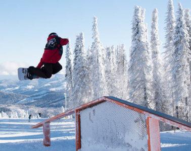 Owen Cline throwing a method grab at Mt. Spokane's Jingle Rails.