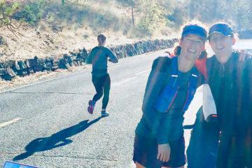 Photo of Summer and Ellen at the 20 mile mark of the Spokane Marathon.