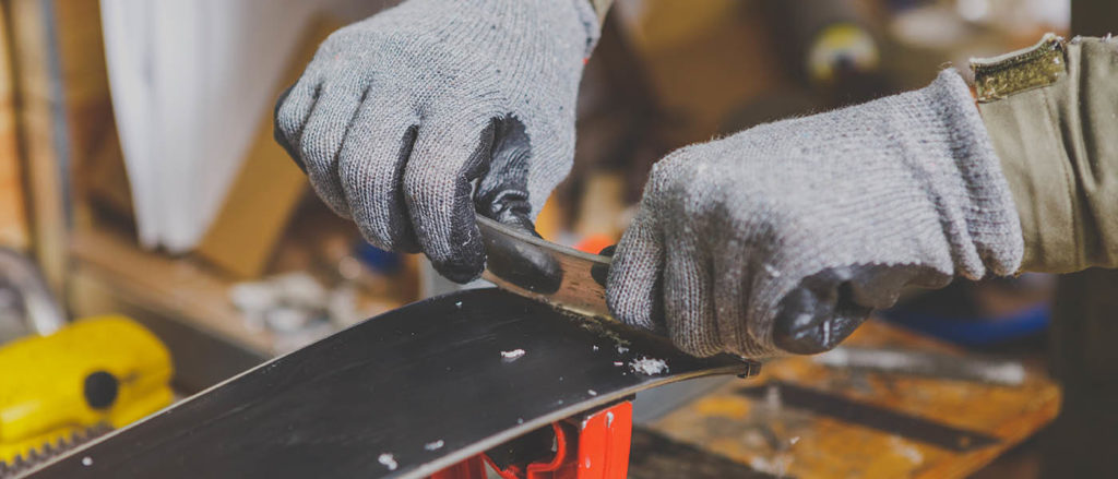 Close up of person waxing a board.