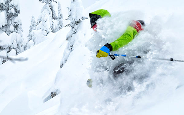 Photo of backcountry skier in powder on Kootenay Pass.