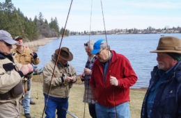 Fly Fishing Students talking on lakeshore.