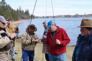 Fly Fishing Students talking on lakeshore.
