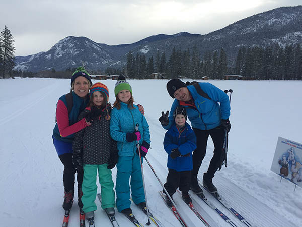 Photo of the Ritchie family posed with cross-country skis.