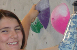 Photo of Helen McGear on the climbing wall.