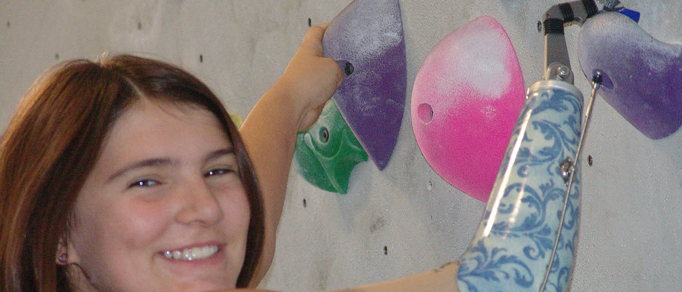 Photo of Helen McGear on the climbing wall.