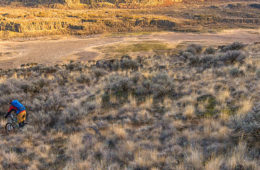 Photo of mountain biker riding through the Scablands taken from above.