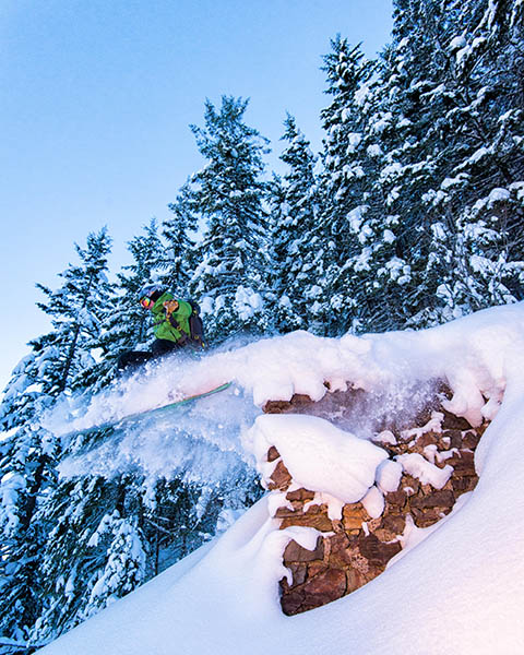 Photo of a skier catching air off of an old mine entrance.