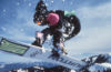 Photo of snowboarder mid air