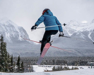 Photo of skier mid air.