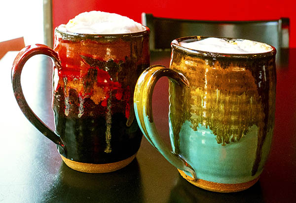 Photo of coffee in hand-painted mugs at the Wallace Coffee House at 6th & Cedar.