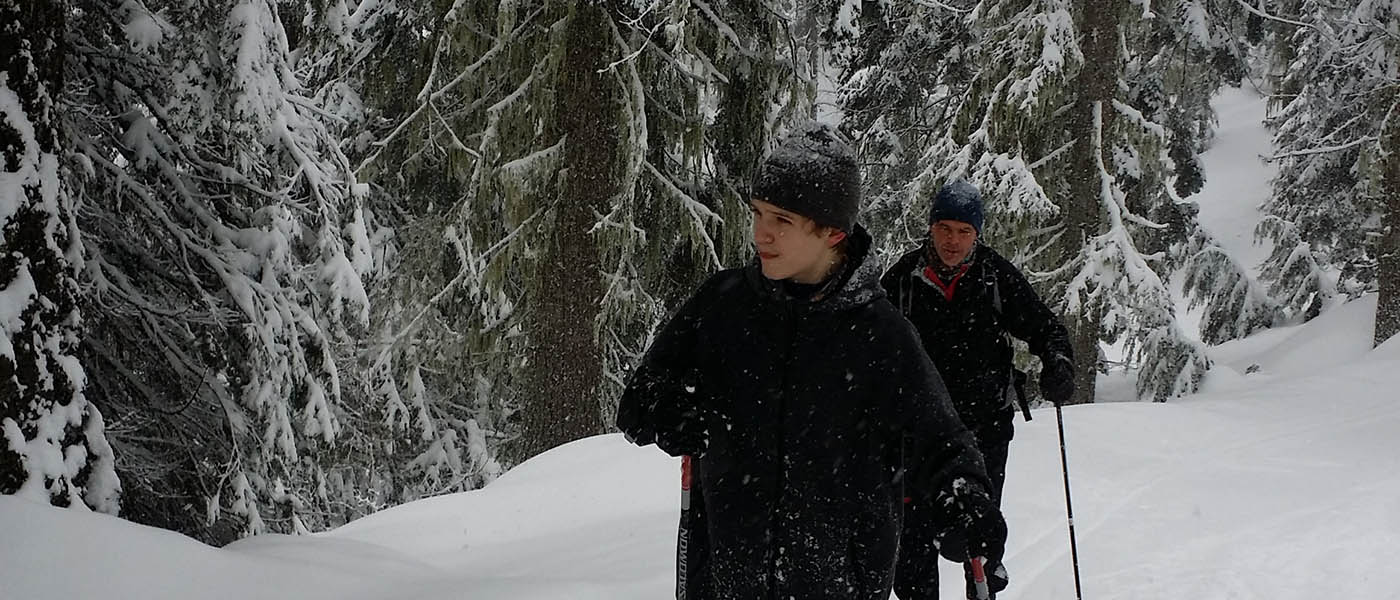 Photo of Trevin Hansen and father cross country skiing.