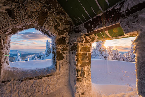 Photo of sunset from inside the hut on Mount Spokane.