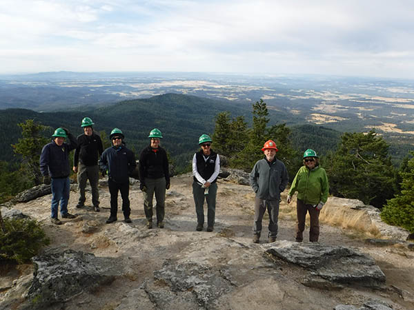 Photo of WTA volunteers on the summit of Mount Kit Carson.
