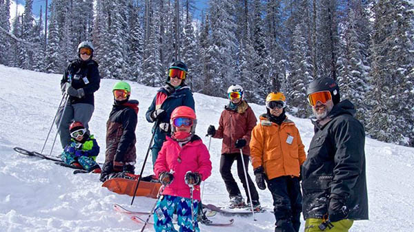 Photo of the Allen family on skis