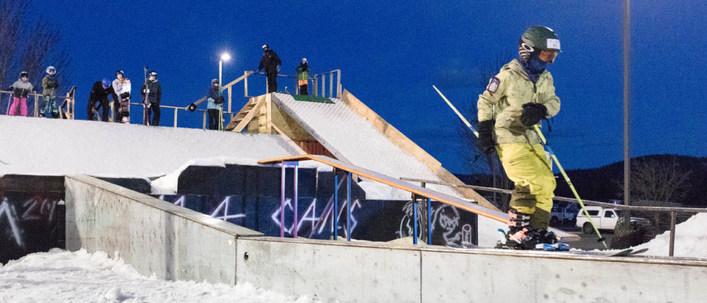 Photo of skier on rail.