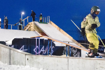 Photo of skier on rail.