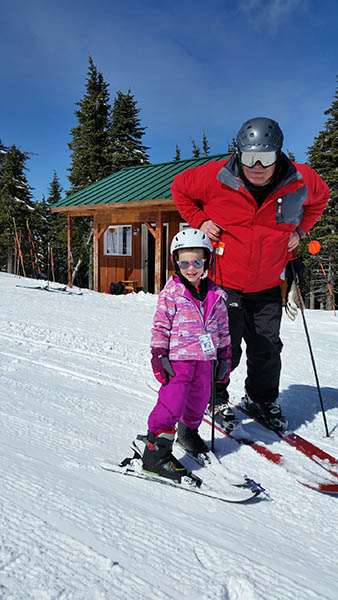 Photo of Doug and his granddaughter, Gabby on skis.