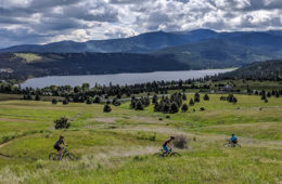 Photo of mountain bikers at the Saltese Uplands from above.