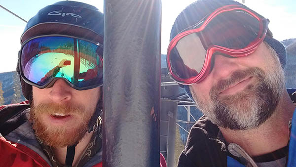 Selfie of Josh Mills and the author on the chairlift.