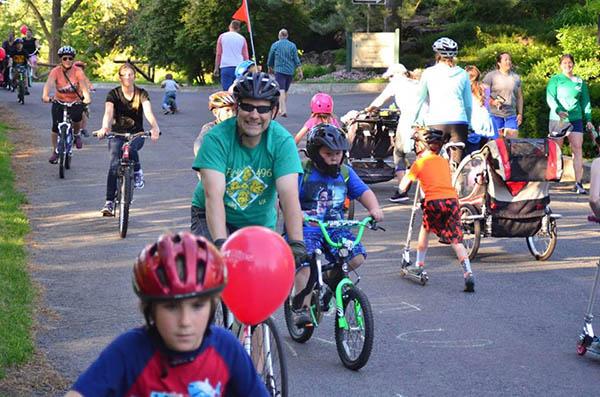 Photo of kids and adults biking along the Centennial Trail.