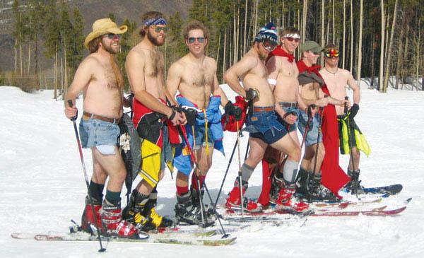 Photo of skiers shirtless wearing cut-offs