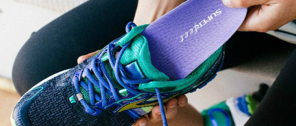 Close up photo of running shoe with Superfeet insoles.