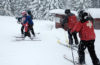Photo of skiers and ski patrol on rope tow.