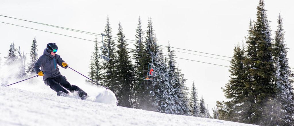 Photo of skier spraying snow.