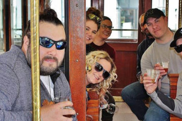 Photo of pub crawlers on trolly.