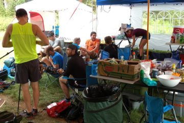 Photo of runners at aid station.