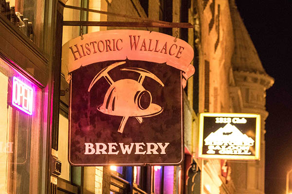 Photo of Wallace Brewery sign at night.