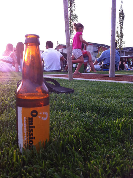 Photo of beer sitting in grass.