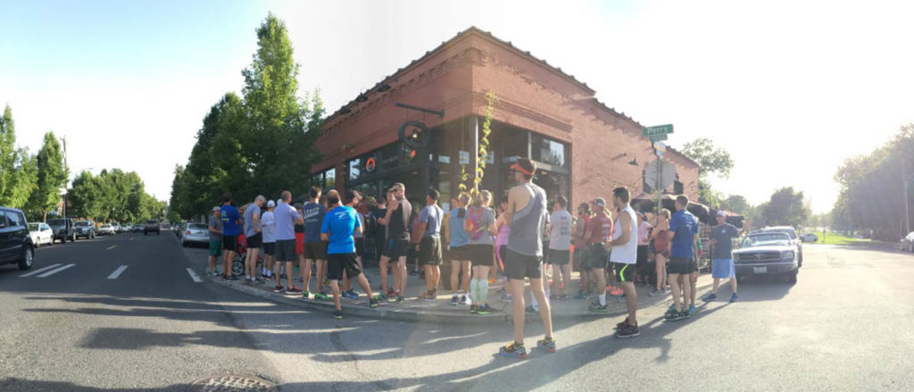Photo of the Lantern Run Club gathered outside of Manito Tap House.