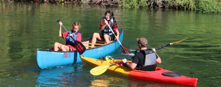 Photo of girls in canoe.