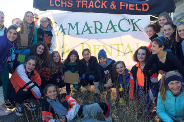 Photo of LCXC volunteers posed in front of aid station.