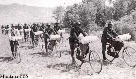 Vintage photo of 25th Regiment -- African-American soldiers -- riding bikes in Wallace, Idaho.