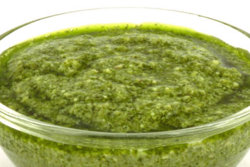 Photo of wild greens pesto in glass dipping bowl.