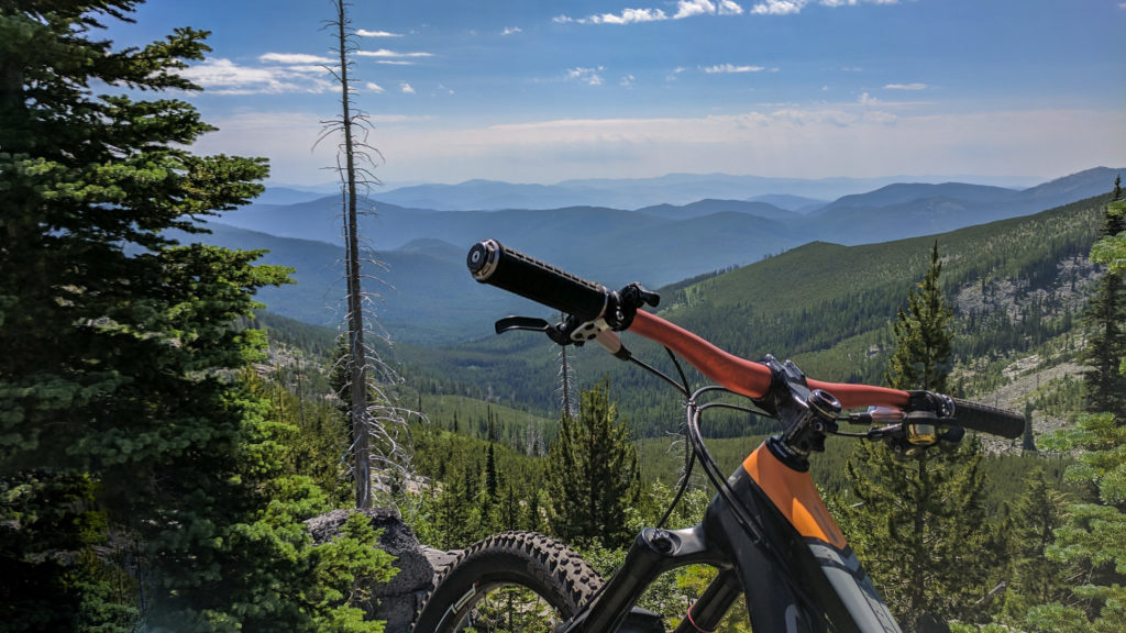 Mountain bike on a trail in the Colville National Forest with a view of the Kettle Crest Range.