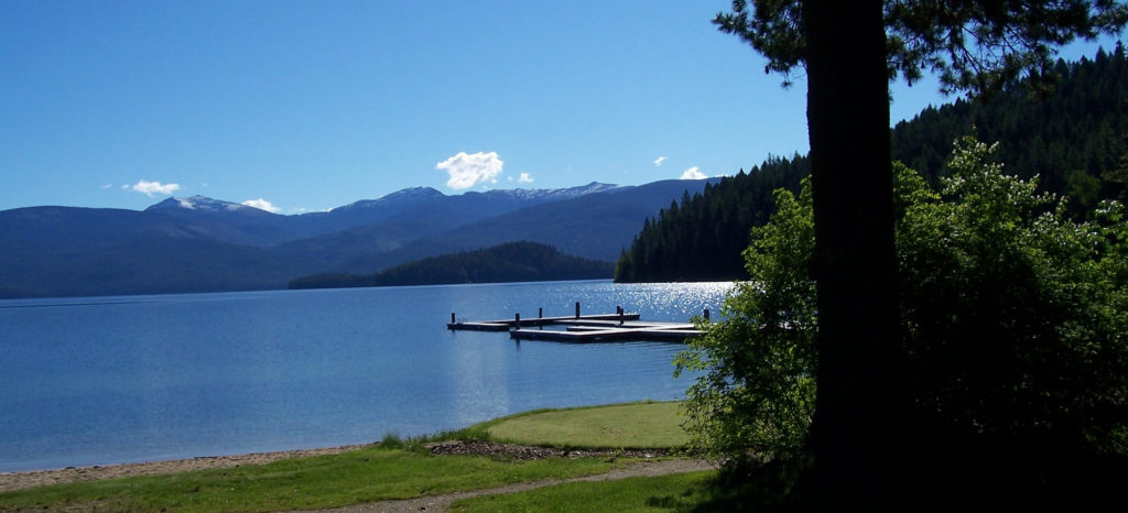 Scenic view of Priest Lake at Hill's Resort, with the resort docks and flat water.