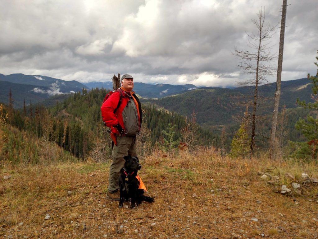 Chase Sanborn hiking with his dog, named Elsie.