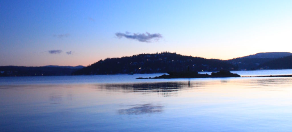 Moon over Coeur d'Alene Lake at sunset.