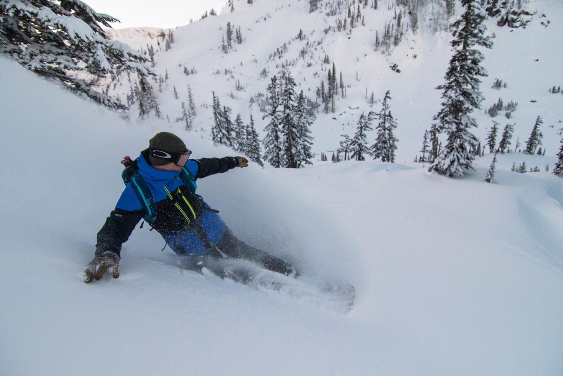 A man snowboarding down a mountain.