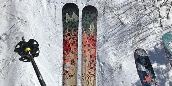 Closeup of ski gear in the snow.