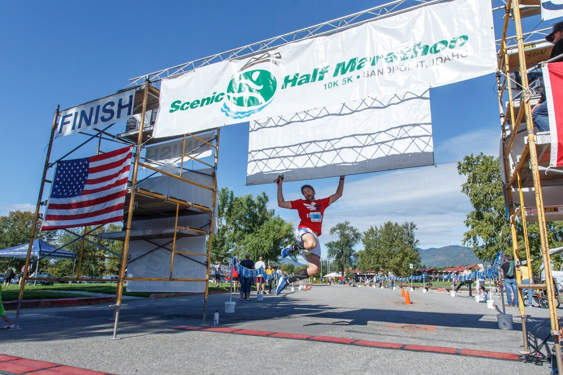 Person jumping over finish line.