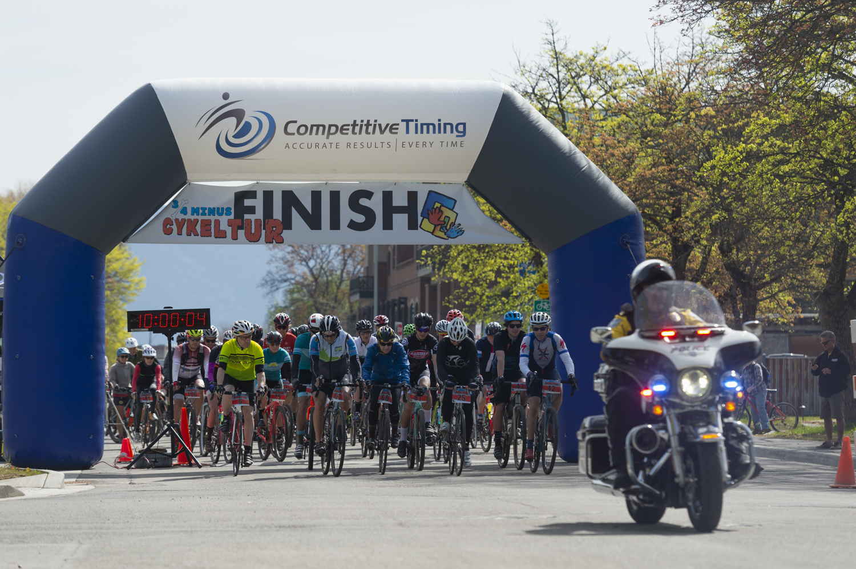 Marathon bikers crossing the finish line.