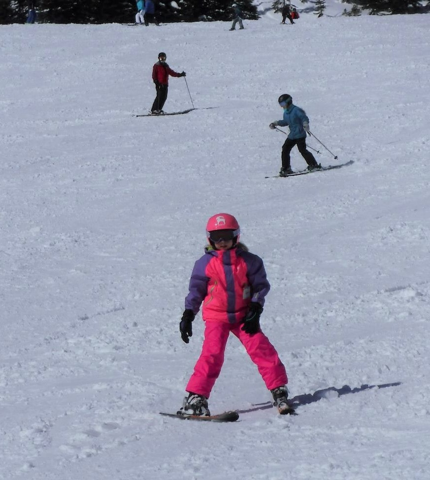 Young skiers going down Midway run at Schweitzer.