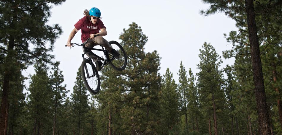A man on a dirt bike doing a trick jump.