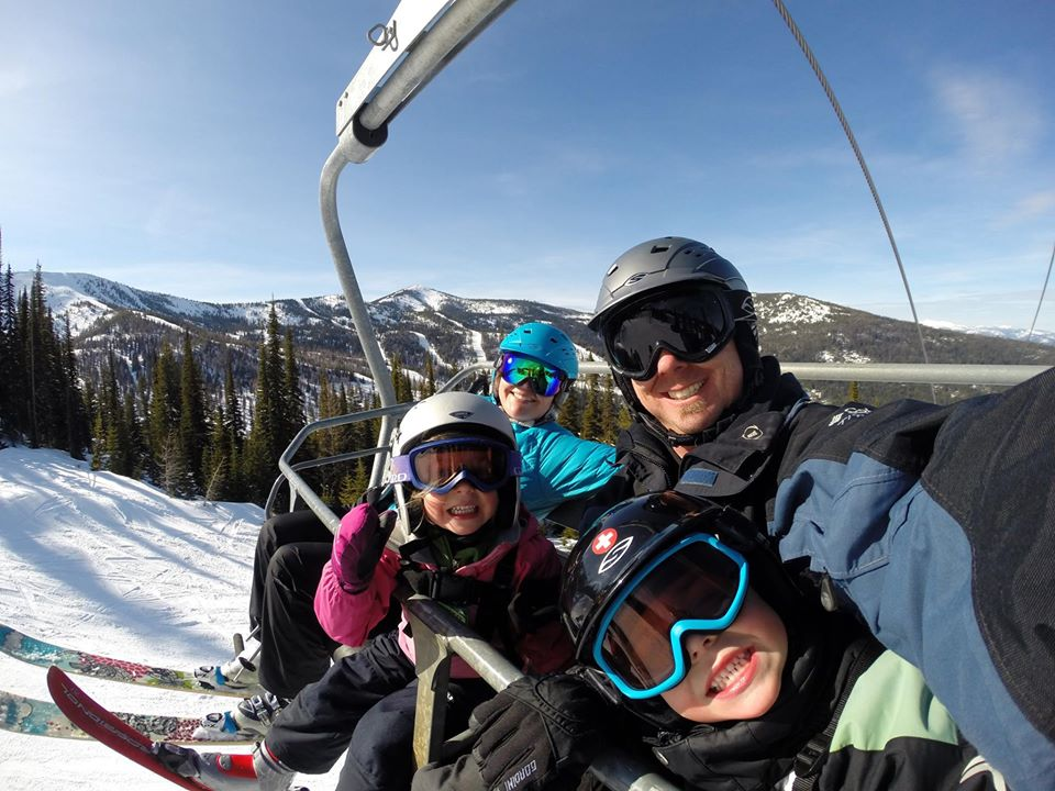 A family selfie on a chair-lift.
