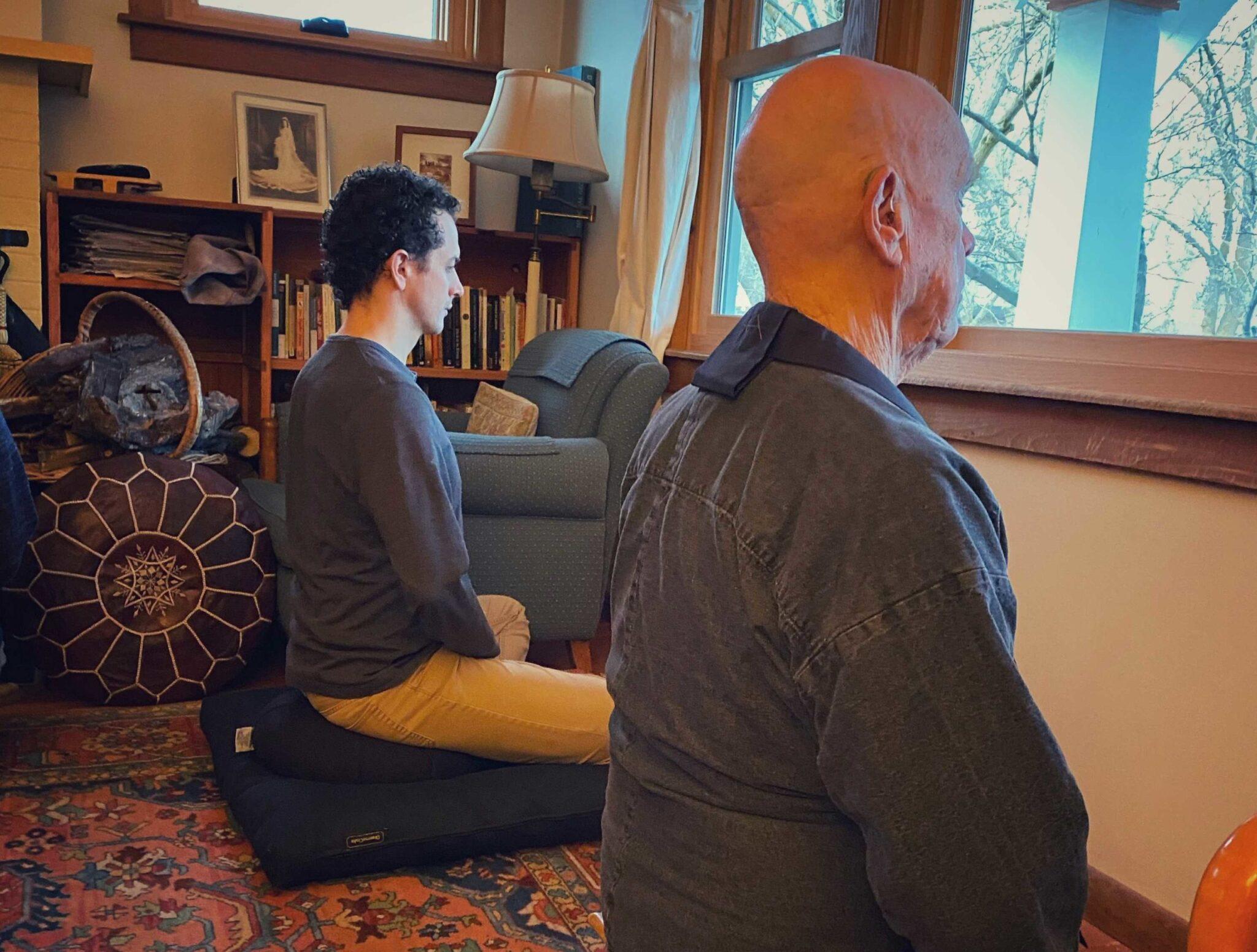 Two people doing yoga meditation.