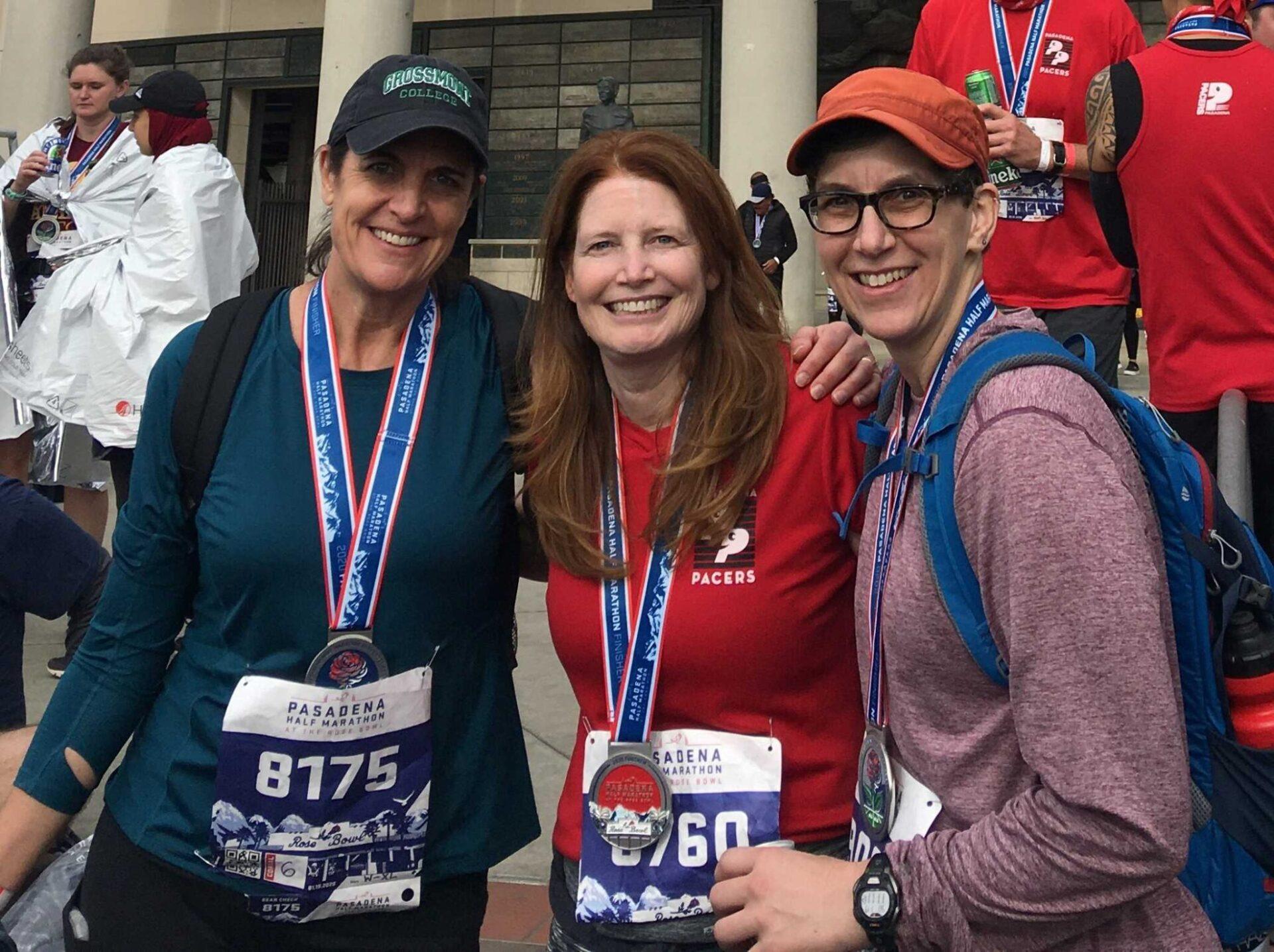 A friend group smiling before a marathon.